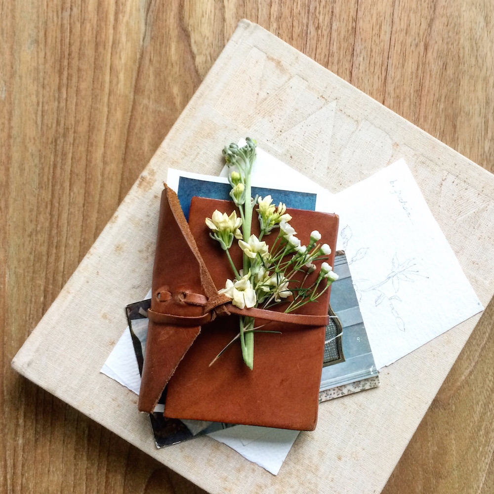 Life Unstyled book and flowers pile