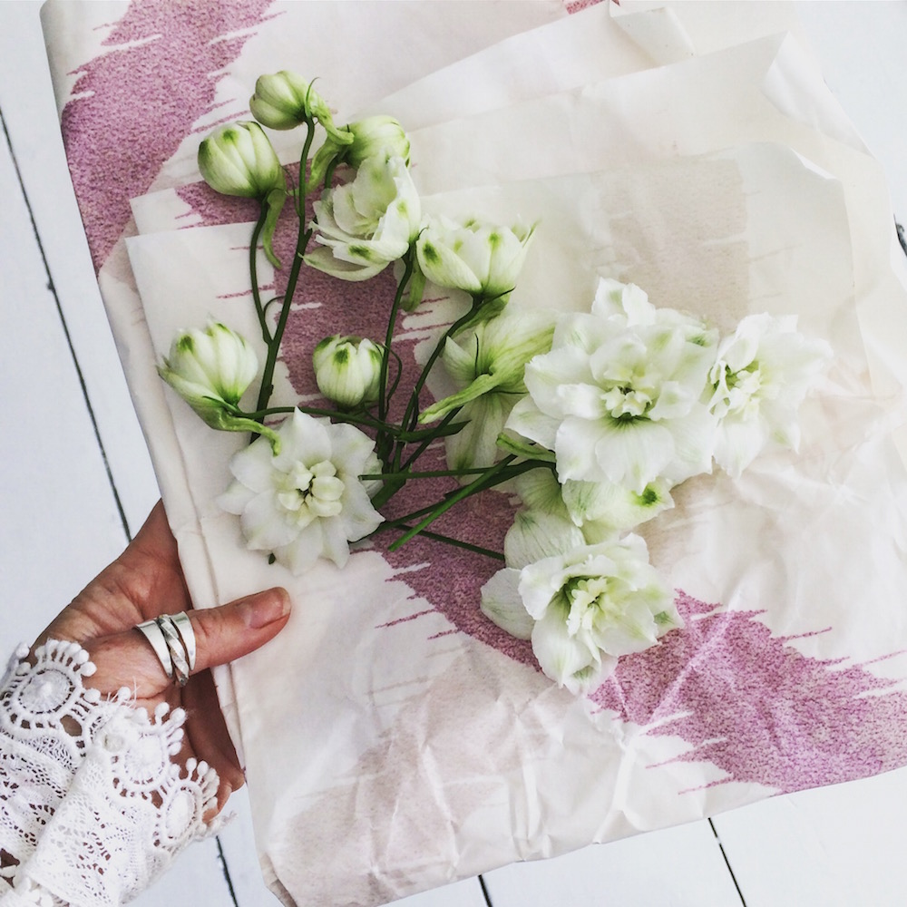 Life Unstyled holding flowers