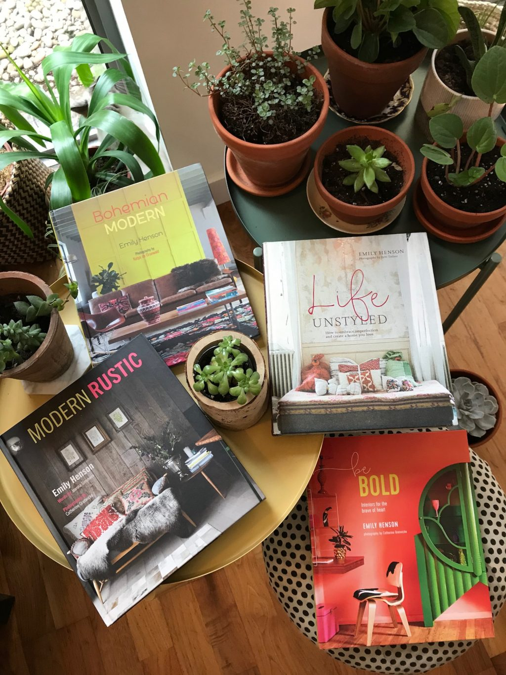 Emily Henson's four interiors books surrounded by plants